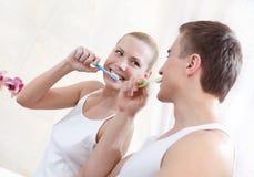 Husband and wife brush teeth Royalty Free Stock Photo