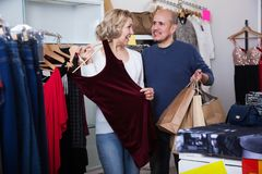 Husband and wife buys some clothes Stock Images