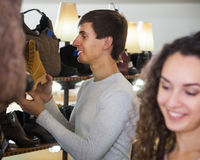 Husband and wife buys some shoes. Husband and wife buys some winter shoes royalty free stock photography