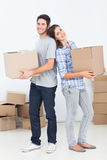 Husband and wife carrying boxes in their new house Stock Photo