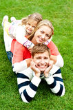 Husband, wife and child piled on each other Royalty Free Stock Photo