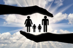 Husband wife and children in his hands Royalty Free Stock Image