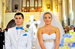 Husband and wife in the church. A just married young couple in the curch stock images