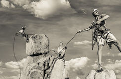 Husband and wife climbing team on the summit. Stock Photography