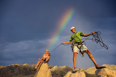 Husband and wife climbing team on the summit. Stock Photo