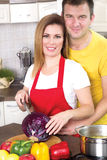 Husband and wife cooking together in the kitchen at home Royalty Free Stock Photography