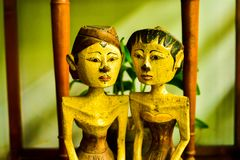 Old vintage traditional wooden statues of husband and wife with local custom fashion stock photography