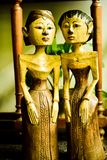 Old vintage traditional wooden statues of husband and wife with local custom fashion royalty free stock photos