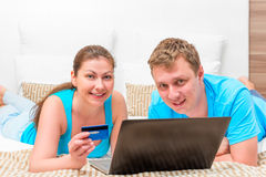 Husband and wife with a credit card and a laptop Stock Image