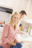 Husband And Wife Doing Dishes Stock Photo