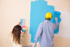 The husband and wife doing renovation at home Stock Photos