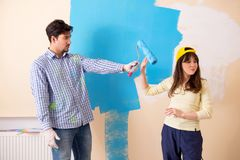 The husband and wife doing renovation at home Royalty Free Stock Images
