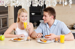 Husband and wife eat in the kitchen Royalty Free Stock Photography