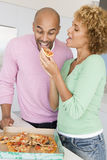 Husband And Wife Eating Pizza Royalty Free Stock Photography
