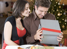 A husband and wife exchanging gifts Royalty Free Stock Image