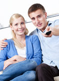 Husband and wife are going to watch TV set Royalty Free Stock Images