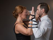 Husband and wife hands tied by tape Stock Photography