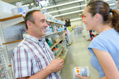 Husband and wife in hardware store. Husband and wife in a hardware store Royalty Free Stock Photo