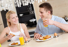 Husband and wife have a snack in the kitchen Royalty Free Stock Image