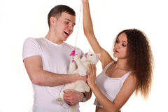 Husband and wife hold cat isolated on white background Stock Photo