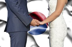 Husband and Wife holding hands - Conceptual photograph of marriage in South Korea stock image