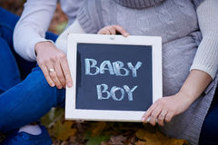 Husband and wife are holding a sign baby Boy Royalty Free Stock Photography