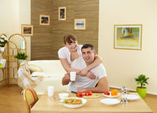 Husband and wife at home in the kitchen Stock Images