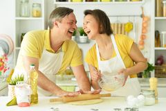 The husband and wife. In the kitchen stock images