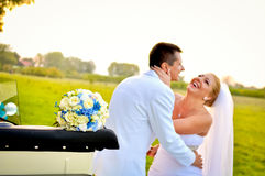 Husband and wife laughing. A just married couple, in the nature stock photo