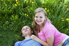 Husband and wife lie on the grass Stock Image