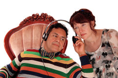 Husband and wife listening on headphone. Stock Image