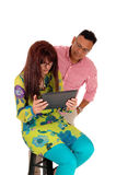 Husband and wife looking at there tablet. Stock Photography