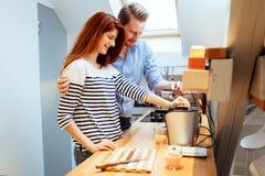 Husband and wife making orange juice Stock Photography