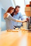 Husband and wife making orange juice Stock Photo