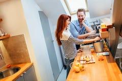Husband and wife making orange juice Stock Image