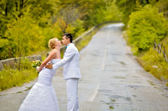 Husband and wife in the nature. A just married young couple, in the nature Royalty Free Stock Photography