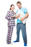 Husband and wife in pajamas on white background posing Stock Photos