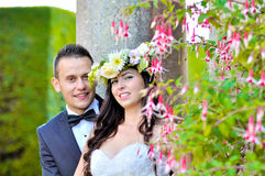 Husband and wife at the palace. A just married couple, through the beautiful gardens of a palace stock images