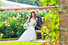 Husband and wife at the palace. A just married couple, in the beautiful gardens of a palace stock images