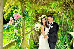 Husband and wife at the palace. A just married couple, in the beautiful gardens of a palace royalty free stock photo