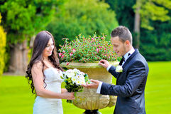 Husband and wife at the palace. A just married couple, in the beautiful gardens of a palace royalty free stock photos