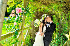 Husband and wife at the palace. A just married couple, in the beautiful gardens of a palace stock image
