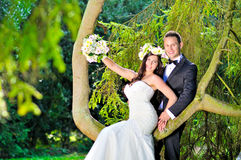 Husband and wife at the palace. A just married couple, in the beautiful gardens of a palace royalty free stock image