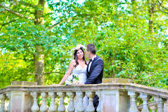 Husband and wife at the palace. A just married couple, in the beautiful gardens of a palace stock photography