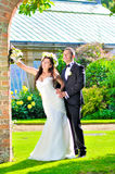 Husband and wife at the palace. A just married couple, in the beautiful gardens of a palace stock photo