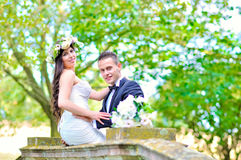 Husband and wife at the palace. A just married couple, in the beautiful gardens of a palace stock photos