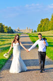 Husband and wife at the palace. A just married couple, in the beautiful gardens of a palace royalty free stock photography