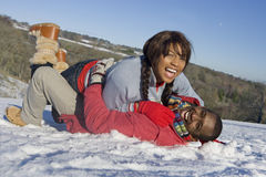 Husband and wife playing in snowy field royalty free stock photos