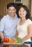 Husband And Wife Preparing Meal Royalty Free Stock Images