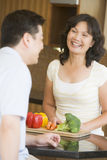 Husband And Wife Preparing Meal Together Royalty Free Stock Photography